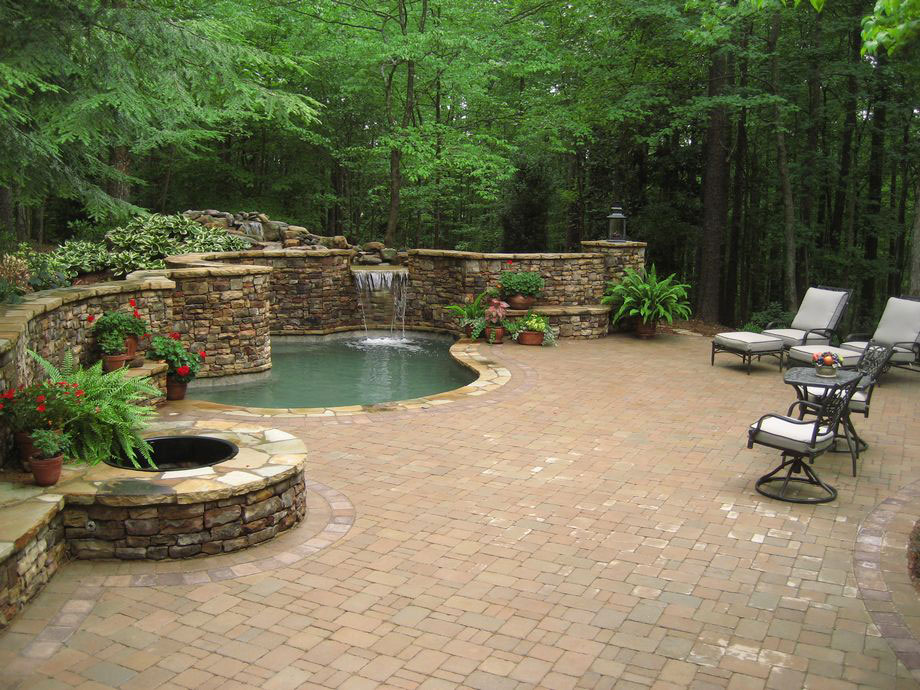 Outdoor Living Pool Firepit Waterfall patio Landscaping